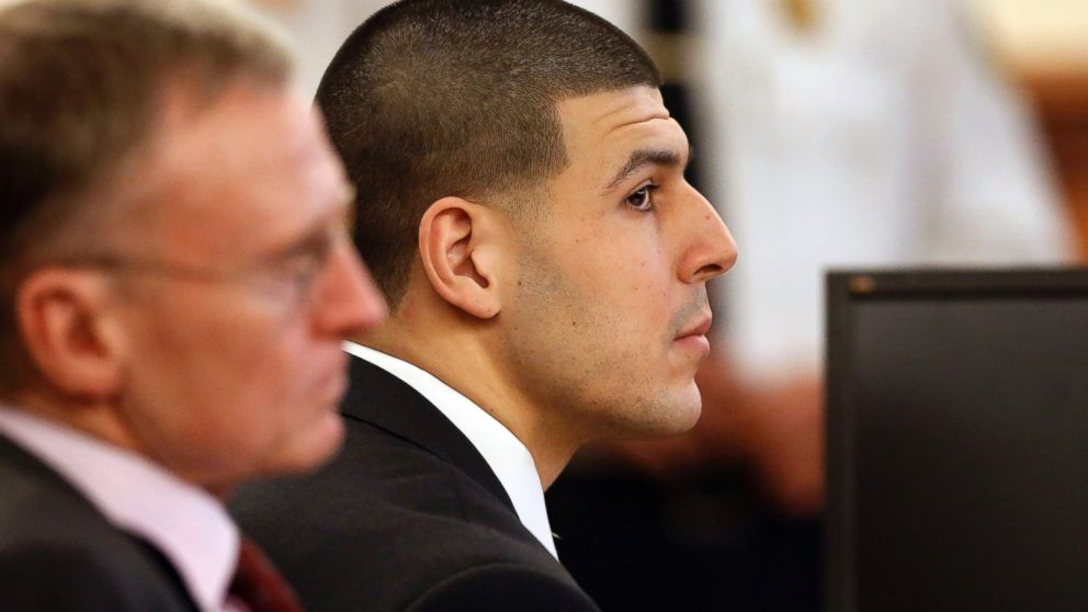 PHOTO: Former New England Patriots football player Aaron Hernandez, right, listens during his murder trial as defense attorney Charles Rankin, left, looks on, Jan. 29, 2015, in Fall River, Mass.