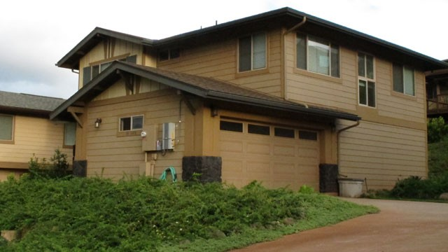PHOTO: The home of civilian defense contractor Benjamin Pierce Bishop in Kapolei, Hawaii on, March 18, 2013. Bishop is charged with giving national security secrets to a 27-year-old Chinese woman he was dating.