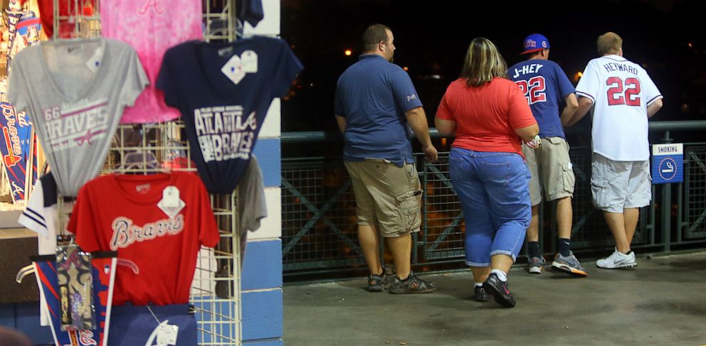 PHOTO: Baseball fans look over a railing at Turner Field near the scene where a man fell 60 feet from the upper deck Monday Aug. 12, 2013. Atlanta police spokesman John Chafee confirmed the death of the man, whose name has not been released.