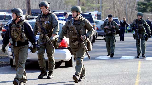 PHOTO: State Police are on scene following a shooting at the Sandy Hook Elementary School in Newtown, Conn., about 60 miles northeast of New York City on Dec. 14, 2012.