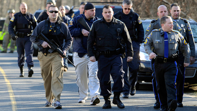 PHOTO: Law enforcement canvass the area following a shooting at the Sandy Hook Elementary School in Newtown, Conn., about 60 miles northeast of New York City on Dec. 14, 2012.