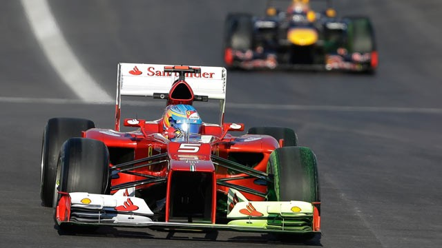 PHOTO: Ferrari driver Fernando Alonso of Spain leads Red Bull driver Sebastian Vettel of Germany into turn one during the first free practice session for the Formula One's U.S. Grand Prix at the Circuit of the Americas, Nov. 16, 2012, in Austin, Texas.
