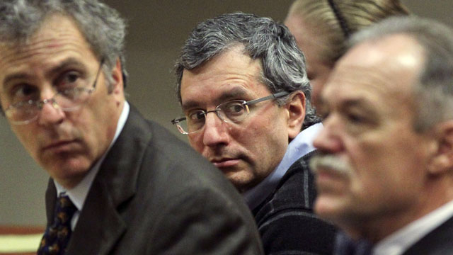 PHOTO: Defendant, Hemy Neuman, center, sits  between his defense lawyers, Bob Rubin, left,  and Doug Peters during his trial, Feb. 24, 2012 at the DeKalb County Courthouse of DeKalb County Superior Court Judge Gregory Adams in Decatur, Ga.