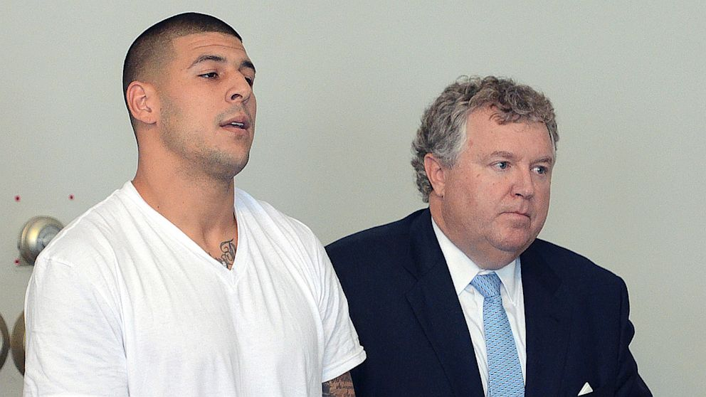 PHOTO: Former New England Patriots tight end Aaron Hernandez, left, stands with his attorney Michael Fee, right, during arraignment in Attleboro District Court on June 26, in Attleboro, Mass., where Hernandez was charged with murdering Odin Lloyd.