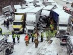 PHOTO: Emergency crews work at the scene of a massive pileup involving about 15 semitrailers and about 15 passenger vehicles and pickup trucks along Interstate 94 Jan. 23, 2014 near Michigan City, Ind. At least three were killed.