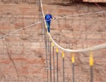 PHOTO: In this photo provided by the Discovery Channel, aerialist Nik Wallenda walks a 2-inch-thick steel cable taking him a quarter mile over the Little Colorado River Gorge, Ariz. on Sunday, June 23, 2013.