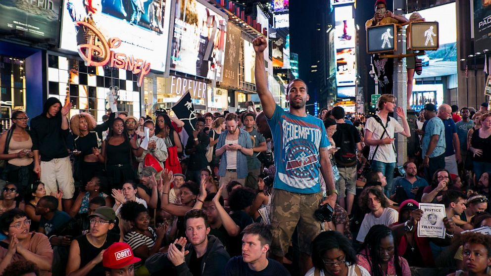 PHOTO: Marchers gather together on Times Square, Sunday, July 14, 2013, in New York, for a protest against the acquittal of volunteer neighborhood watch member George Zimmerman in the 2012 killing of 17-year-old Trayvon Martin in Sanford, Fla.