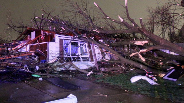 PHOTO: A tree fell on a home on Lynn Haven Lane in Hazelwood, Missouri during a storm that caused extensive damage to homes and businesses on Wednesday, April 10, 2013.