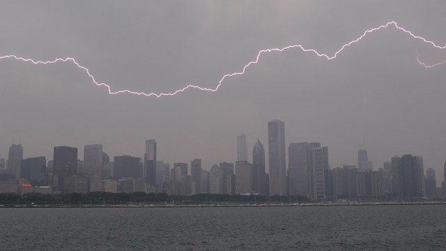 PHOTO: Lighting flashes over the Chicago skyline, Wednesday, June 12, 2013. An unusually massive line of storms packing hail, lightning and tree-toppling winds was rolling through the Midwest.