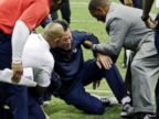 PHOTO: Houston Texans head coach Gary Kubiak, center, his helped after he collapsed on the field during the second quarter of an NFL football game against the Indianapolis Colts, Sunday, Nov. 3, 2013, in Houston.