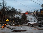 PHOTO: Hardy Street in front of the University of Southern Mississippi campus is obstructed by debris blown by an apparent tornado in Hattiesburg, Miss., Sunday, Feb. 10, 2013.