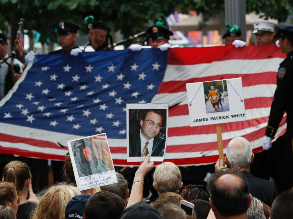PHOTO: Mourners hold photos of their loved ones during the 15th anniversary of the attacks of the World Trade Center at the National September 11 Memorial, Sept. 11, 2016, in New York.