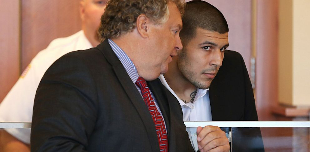 PHOTO: Aaron Hernandez listening to his lawyer
