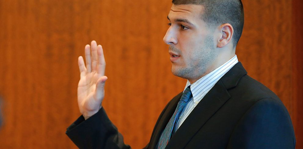 PHOTO: Former New England Patriots NFL football player Aaron Hernandez takes an oath during a pretrial court hearing in Fall River, Mass., Oct. 9, 2013.