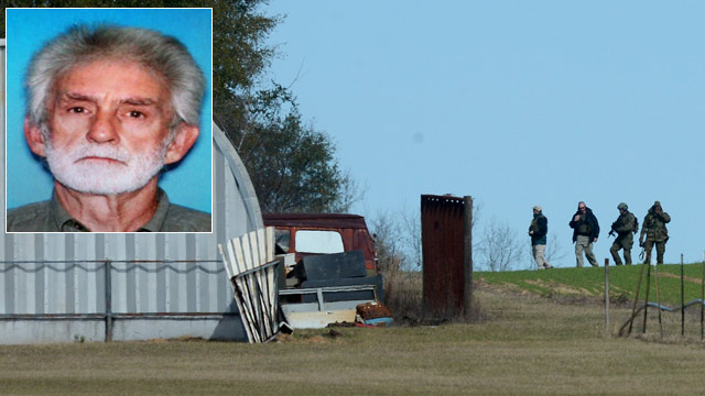 PHOTO: A neighbor of the retired Alabama trucker who is holed up in an underground bunker with a youn
