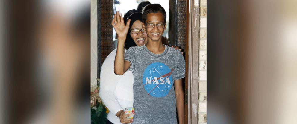 PHOTO: Ahmed Mohamed, 14, right, waves to the media from the front door of his house as his sister, Eyman Mohamed, looks on before a news conference, Sept. 16, 2015, in Irving, Texas.