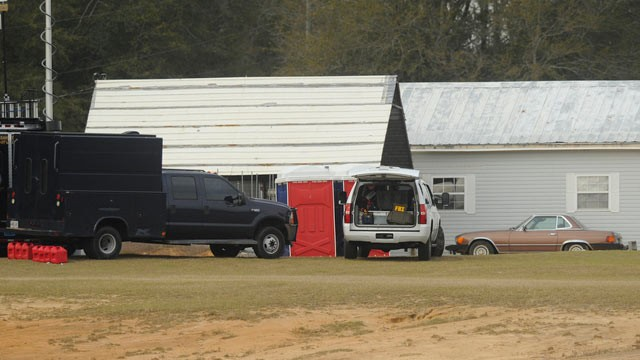 PHOTO: Law enforcement personnel station themselves on the property of Jimmy Lee Sykes, Feb. 4, 2013, in Midland City, Ala. Officials say they stormed a bunker in Alabama to rescue a 5-year-old child being held hostage there after Sykes, his abductor, was