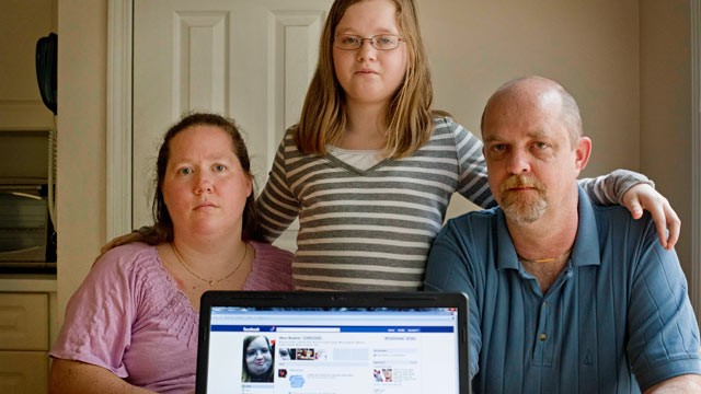 PHOTO: Alex Boston, 14, center, poses with her mom Amy, and father Chris and a screen shot of the phony Facebook account that was set up in Alex's name, April 26, 2012, at their home in Acworth, Ga.