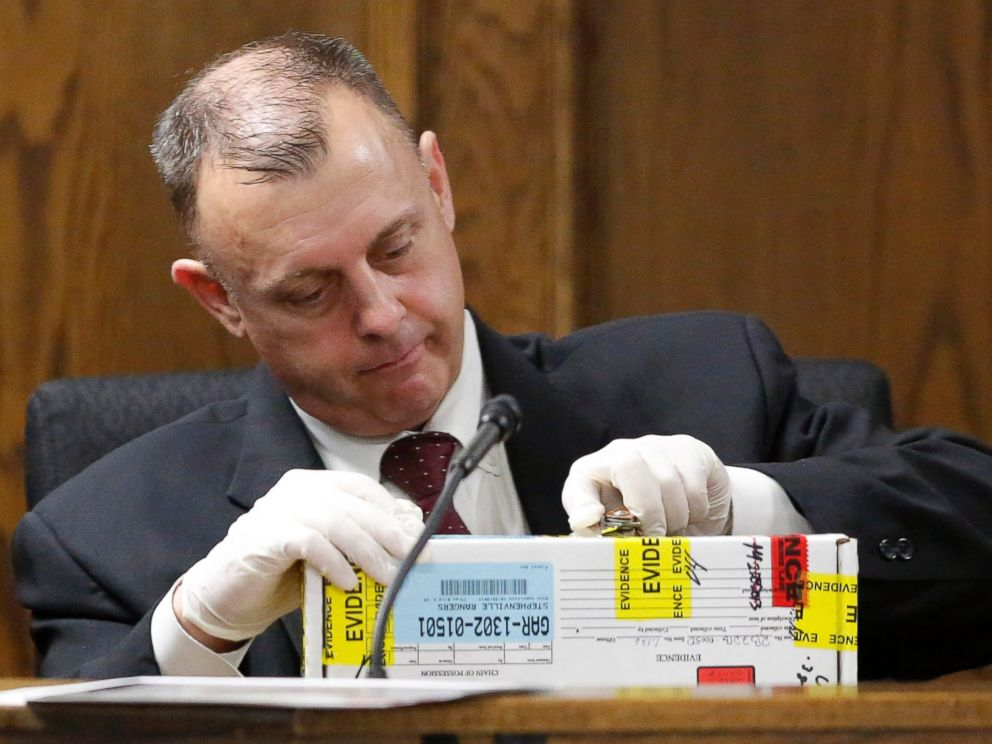 PHOTO: Texas Ranger Michael Adcock opens boxed evidence as he testifies during the second day of former Marine Cpl. Eddie Ray Rouths capital murder trial in Stephenville, Texas, Thursday, Feb. 12, 2015.