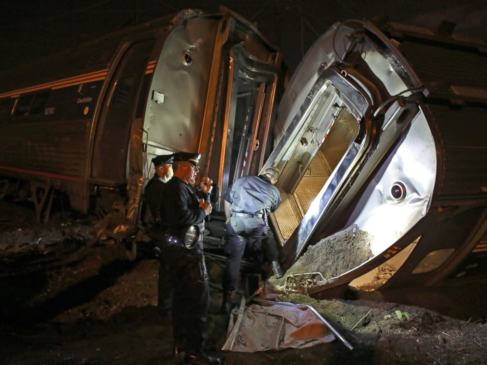 PHOTO: Emergency personnel work the scene of a train wreck, May 12, 2015, near Philadelphia.