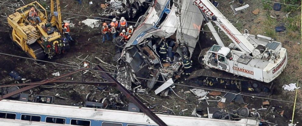PHOTO: Emergency personnel work at the scene of a deadly train wreck, May 13, 2015, in Philadelphia.