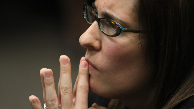 PHOTO: Andrea Sneiderman listens during opening statements by prosecutor Don Geary in Atlanta, Feb. 21, 2012.