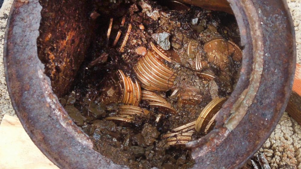 PHOTO: A image provided by the Saddle Ridge Hoard shows one of six decaying metal canisters filled with 1800s-era U.S. gold coins unearthed in California by two people who want to remain anonymous. The value of the treasure is estimated at $10 million.