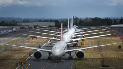PHOTO: A line of Boeing 787 Dreamliners waiting to be delivered are shown on a closed runway, June 18, 2013 at Paine Field near Boeing's Everett, Wash. assembly plant.