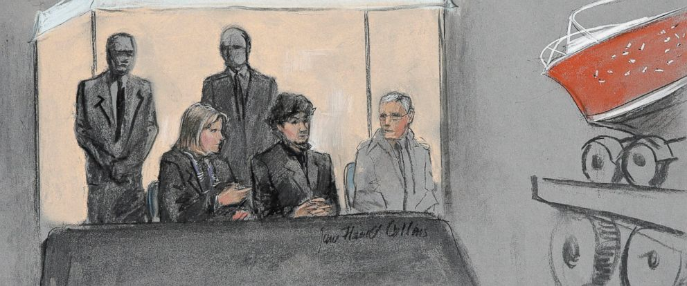 PHOTO: In this courtroom sketch, Dzhokhar Tsarnaev, center seated, is depicted between defense attorneys while the boat in which he was captured in sits on a trailer for observation during his federal death penalty trial, March 16, 2015, in Boston.