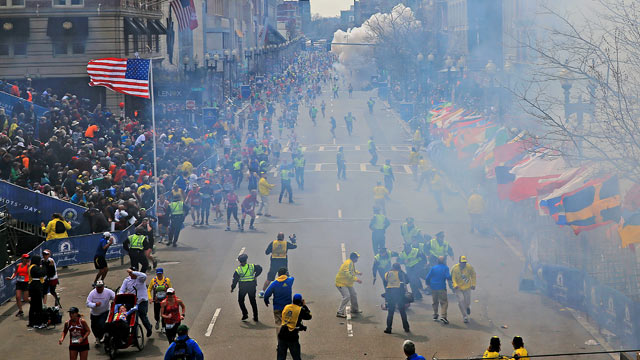 PHOTO: People react as an explosion goes off near the finish line of the 2013 Boston Marathon in Boston on April 15, 2013.