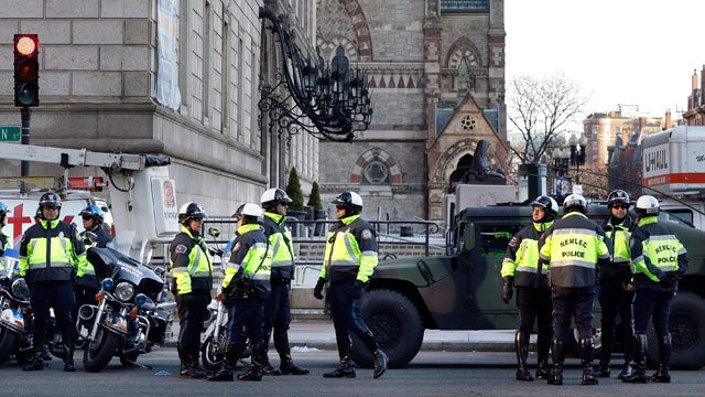 PHOTO: Boston police officers keep a perimeter secure in Bostons Copley Square, April 16, 2013 as an investigation continues into the bomb blasts at the finish area of the Boston Marathon.