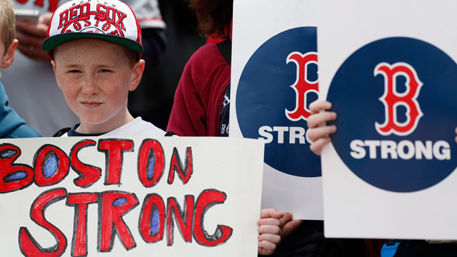 "PHOTO: A young fan holds a ""Boston Strong"" sign before a baseball game between the Boston Red Sox and the Kansas City Royals in Boston, April 20, 2013."