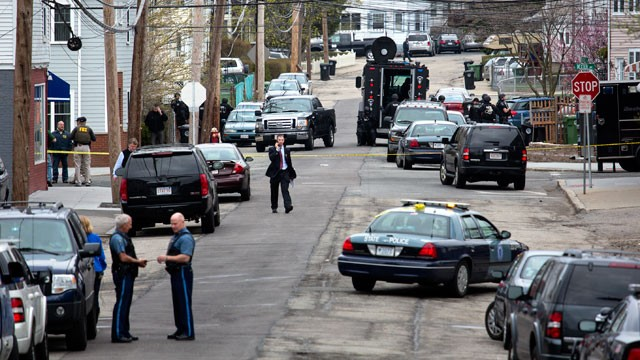 PHOTO: Police presence grows in the neighborhoods of Watertown, Mass., April 19, 2013, as a massive search involving hundreds of heavily armed law enforcement officials continues for one of two suspects in the Boston Marathon bombing.