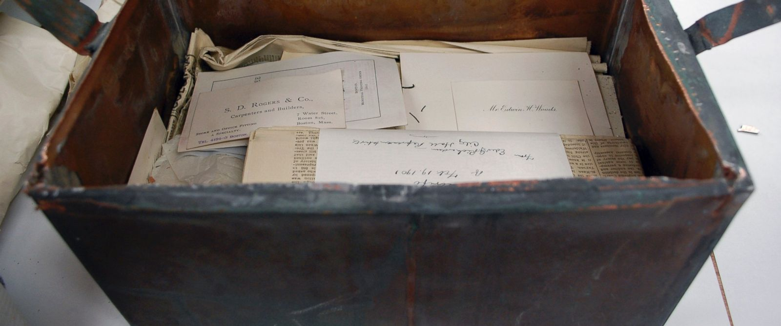 PHOTO: Items are stacked inside a shoebox-sized 1901 time capsule in Boston in a photo released on Oct. 15, 2014.