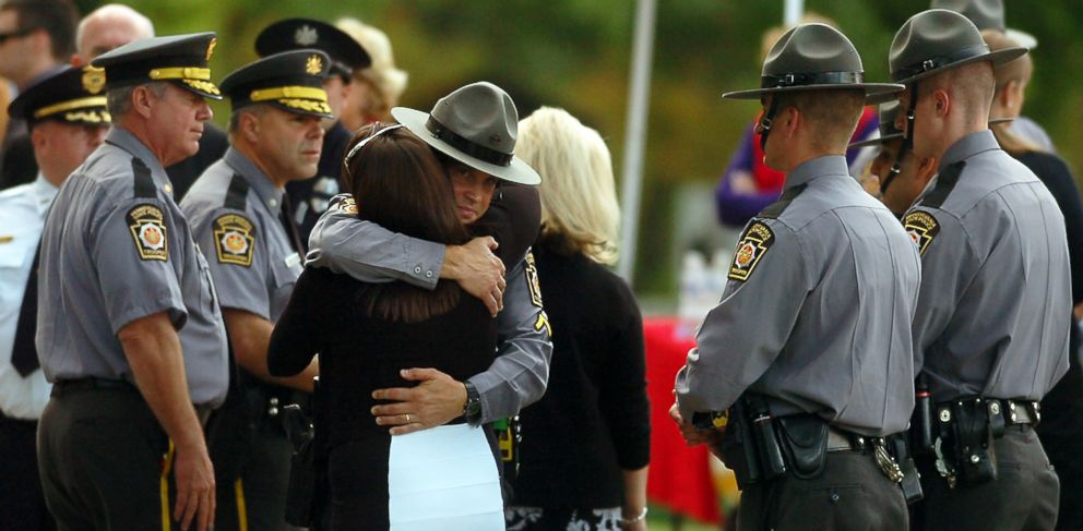 PHOTO: A woman embraces a Pennsylvania State Trooper during the viewing of Cpl. Bryon Dickson on Sept. 17, 2014 in Scranton, Pa.