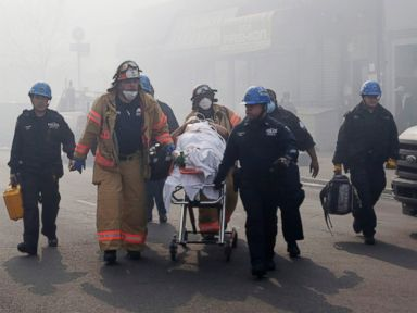 PHOTO: Rescue workers remove an injured person on a stretcher following a building explosion and collapse in East Harlem, March 12, 2014 in New York.