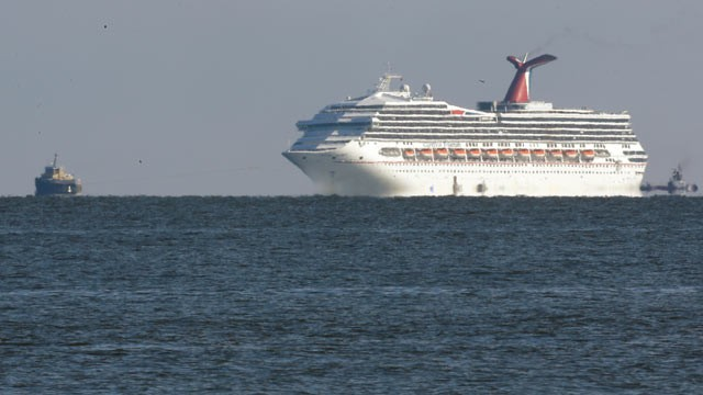 PHOTO: The cruise ship Carnival Triumph is towed towards Mobile Bay near Dauphin Island, Ala., Feb. 14, 2013.