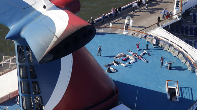 "PHOTO: Passengers spell out the word ""HELP"" aboard the disabled Carnival Lines cruise ship Triumph as it is towed to harbor off Mobile Bay, Ala., Feb. 14, 201"