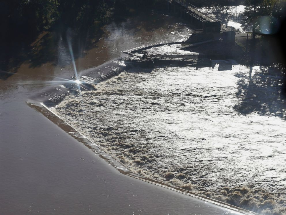 PHOTO: Floodwaters rush over a diversion dam in Columbia, S.C., Oct. 6, 2015.