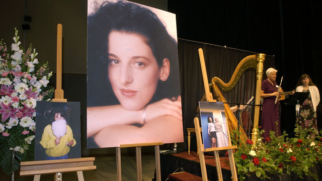 PHOTO: In this May 28, 2002 file photo, photographs of Chandra Levy are on display as musicians, right, stand by at the memorial service for Levy at the Modesto Centre Plaza in Modesto, Calif.