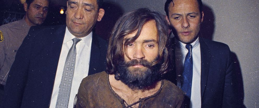PHOTO: Charles Manson is escorted to his arraignment on conspiracy-murder charges in connection with the Sharon Tate murder case, 1969, Los Angeles, Calif.