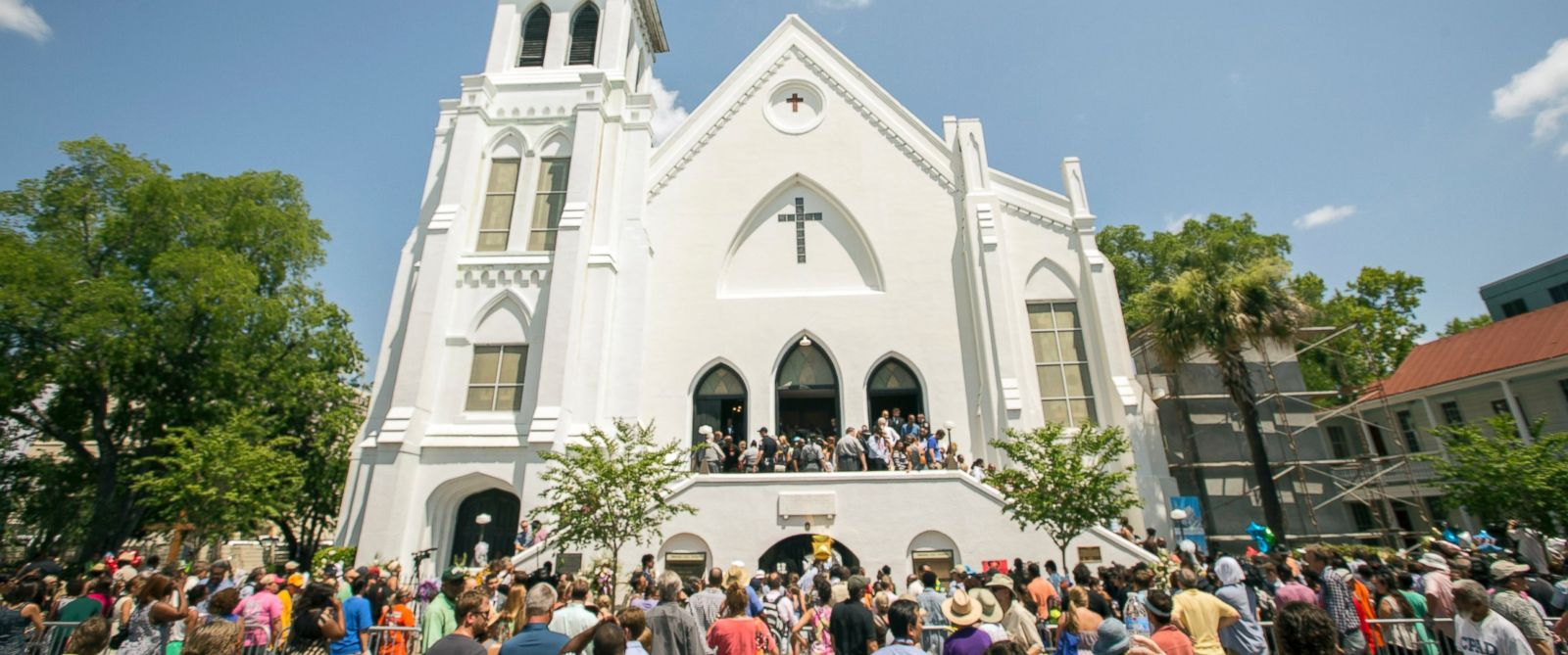 PHOTO: People stand outside as parishioners leave the Emanuel A.M.E. Church, Sunday, June 21, 2015, in Charleston, S.C.