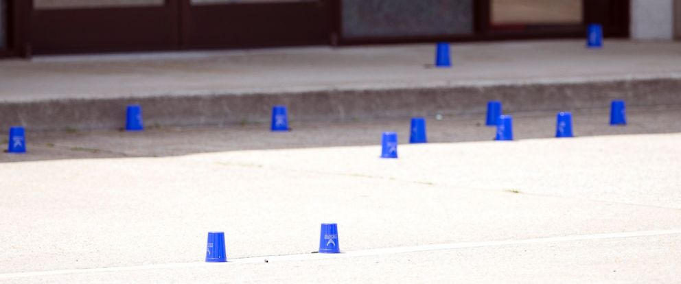 PHOTO: Plastic cups mark evidence outside the Armed Forces Career Center after a gunman open fire on the building, July 16, 2015, in Chattanooga, Tenn.