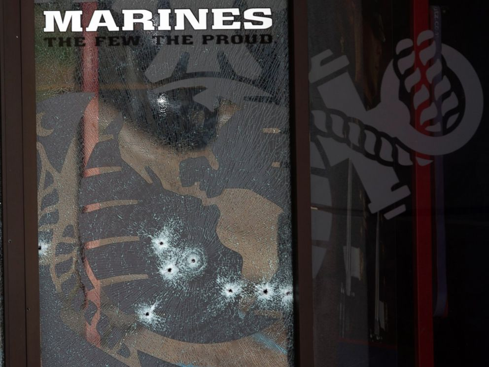 PHOTO: The glass window of the Armed Forces Career Center is riddled with bullet holes after a gunman opened fire on the building, July 16, 2015, in Chattanooga, Tenn.