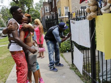 PHOTO: Antonio Brown, left, father of Amari Brown, is embraced by a community member, July 6, 2015, in Chicago.