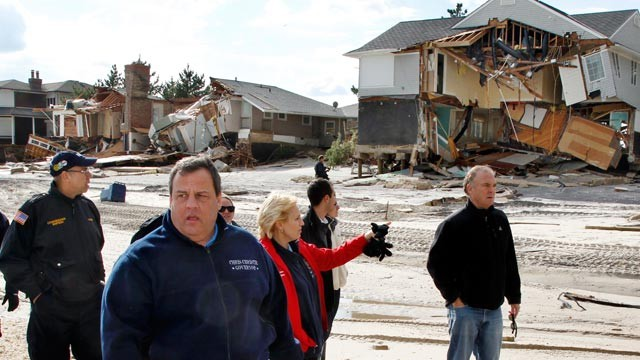 PHOTO: New Jersey Gov. Chris Christie, center left, passes damaged homes along the Atlantic Ocean, Nov. 2, 2012, in Mantoloking, N.J., as they tour some of the region devastated by superstorm Sandy.