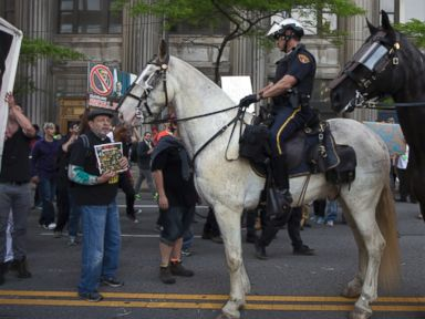 PHOTO: Mounted police follow demonstrators as they march through downtown during a protest against the acquittal of Michael Brelo, a patrolman charged in the shooting deaths of two unarmed suspects, Saturday, May 23, 2015, in Cleveland.