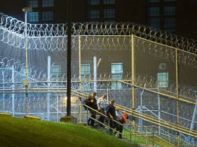 PHOTO: Corrections officers walk next to a fence covered in razor wire as they leave work at Clinton Correctional Facility in Dannemora, N.Y., June 15, 2015.