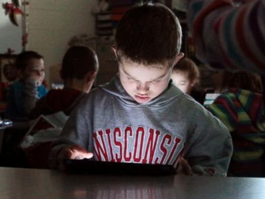 PHOTO: Friess Lake third-grade student Jacob Lorbecki, 8, loads his coding program as part of the Hour of Code event in Richfield, Wis., Dec. 11, 2014.
