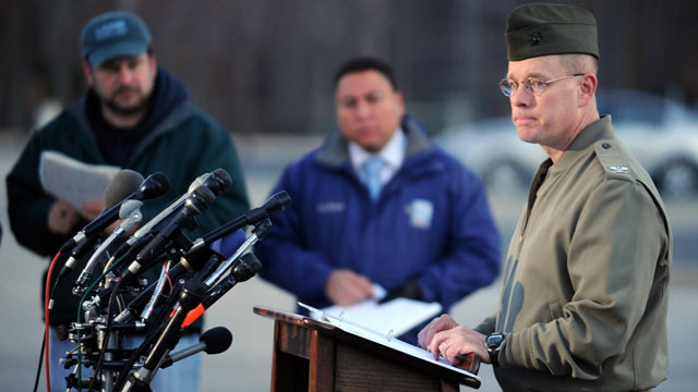 PHOTO: Col. David W. Maxwell holds a press conference at the Marine Corps Museum in Quantico, Va., March 22, 2013 regarding a murder/suicide that occurred and resulted in the deaths of three Marines.